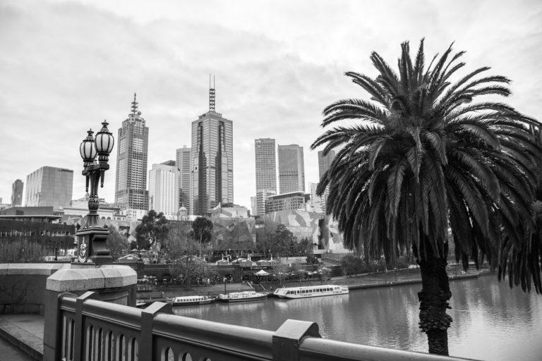 Black and white city view looking over flinders street bridge melbourne